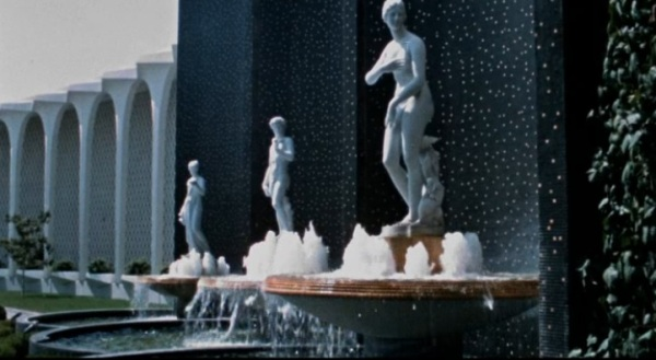 Statuary fountains flanking the porte cochere