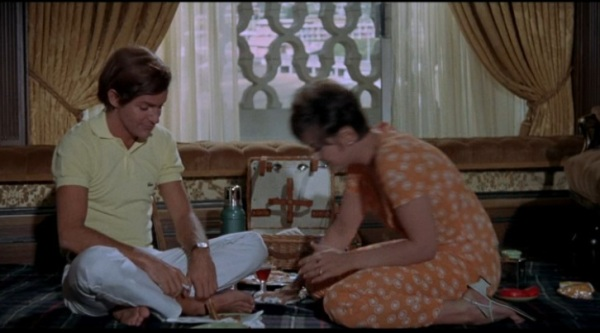 Picnic in the executive office; Brenda Vaccaro played the boss's secretary, who develops at crush on his son (Drivas).