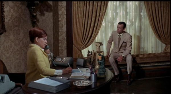 Look at all the matchbooks on the secretary's desk! I have a few of these, but one can never have too many matchbooks.