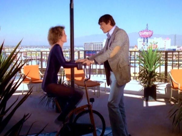 A penthouse patio at the Desert Inn. Notice the Stardust sign in the background.