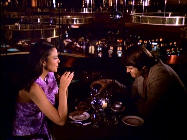 Kim Cattrall and Robert Urich dine on a balcony inside the Desert Inn casino.