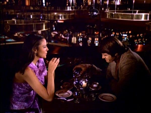 Kim Cattrall and Robert Urich dine on a balcony inside the Desert Inn casino.