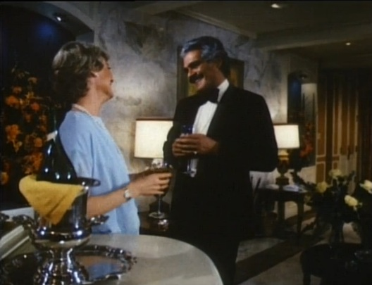 Lange and Sharif toast champagne in the penthouse, which Lange's character--the owner of Caesars--lived in.