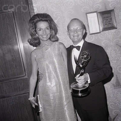 Lee and Truman with an Emmy, undoubtedly not won for her TV movie role he secured for her in 1968