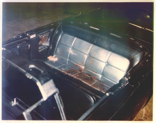 Photo taken on 11.23.63, one day after the assassination. Flowers still lay on the back seat of the limo, even though it's been transported from Dallas to the White House garage.