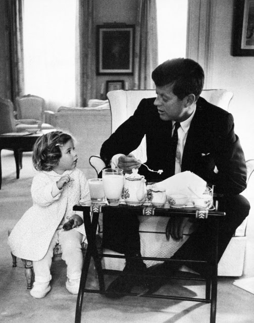 Carolyn Kennedy and her father enjoy tea in his office.