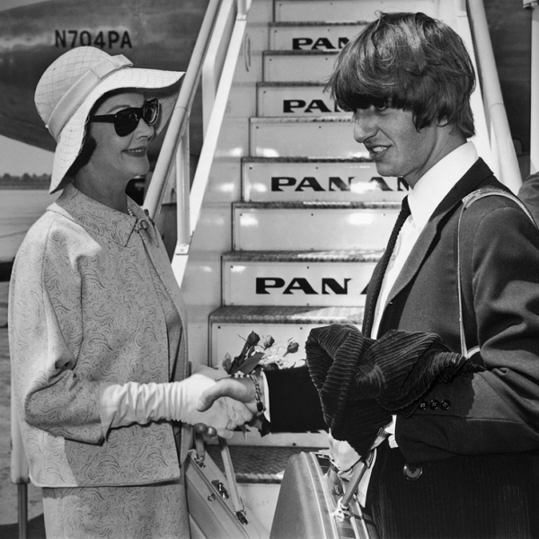 Vivien Leigh chats with Ringo Starr during a chance meeting at the airport during the Swingin' 60s